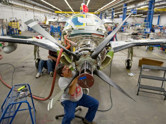 In this 2012 file photo, Gar Boneta is working on the final assembly line at Piper Aircraft. The Vero Beach-based aircraft manufacturer has added at least 200 employees this year and is looking to fill at least 65 new positions in the next few months.