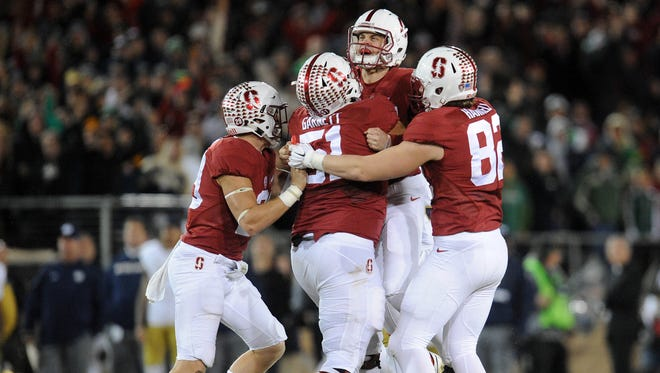 November 28, 2015; Stanford, CA, USA; Stanford Cardinal place kicker Conrad Ukropina (34) is congratulated after kicking the game winning field goal to win 38-36 against Notre Dame Fighting Irish during the second half at Stanford Stadium. Mandatory Credit: Gary A. Vasquez-USA TODAY Sports