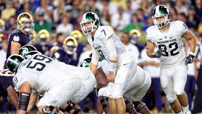 Michigan State quarterback Tyler O'Connor (7) looks over the Fighting Irish defense during the second half a game at Notre Dame Stadium.