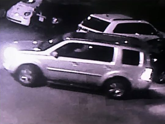 This a surveillance image of an SUV that a missing