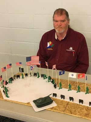 Chris Green has built a model of the memorial he'd like to see in Colerain Township to honor veterans. He says it will cost $1 million to build and will likely be developed in phases.
