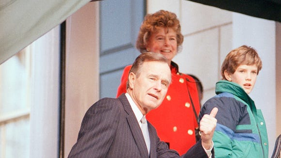 President-elect George H. W. Bush greets his sister Nancy Ellis and an unidentified grandson outside of Blair House Jan. 20, 1989 in Washington.