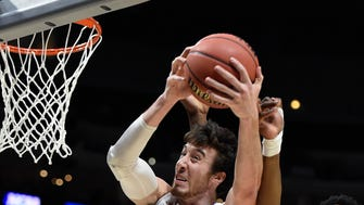 Wisconsin Badgers forward Frank Kaminsky (44) grabs a rebound  against Arizona Wildcats during the first half in the finals of the west regional of the 2015 NCAA Tournament at Staples Center.