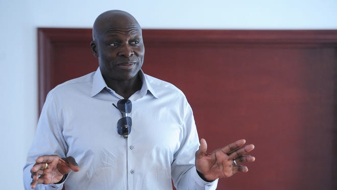 NFL Hall of Fame defensive end Bruce Smith speaks to a group at a week-long boys camp at First Baptist Church Capeville on Monday, Aug. 1, 2016. Smith, the all-time sack leader in NFL history, spoke to the boys in attendance about making good life choices with an emphasis on education and hard work.