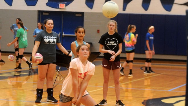 Makarah Hollinger, a rising sixth grader at Beverley Manor Middle School, waits for the ball during a volleyball drill at Fort Defiance High School Tuesday morning.