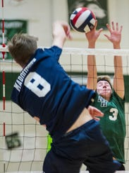 Joey Robers of West Allis Hale (right) blocks a spike