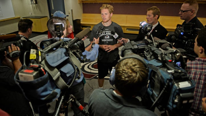 DENVER, CO - SEPTEMBER 18: Colorado Avalanche hockey player Gabriel Landeskog talks to media, September 18, 2014. Avalanche veterans reported today for physicals and media availability at the Pepsi Center.
