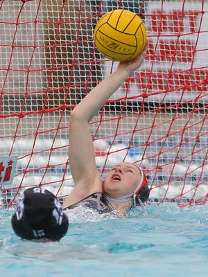 Xavier Prep's Savy Jessup makes a save in the 3rd quarter against Cajon High School during their CIF quarterfinal match at Palm Desert Aquatic Center on February 18, 2017. Xavier won the match.