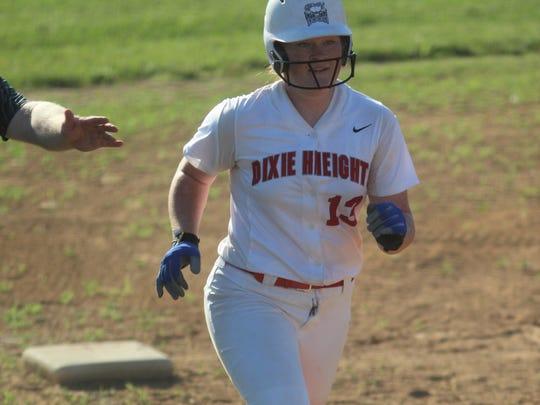 Dixie Heights junior Kaylee McGinn rounds third base