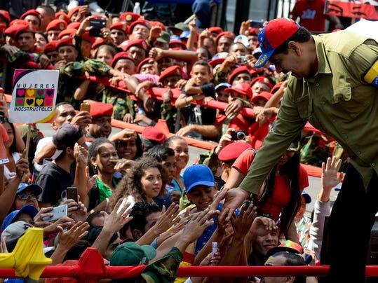 VENEZUELA-POLITICS-COUP-CHAVEZ-ANNIVERSARY-MADURO