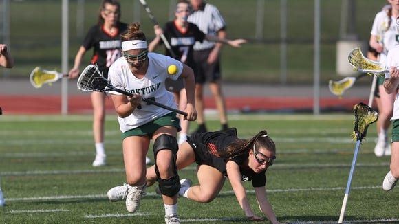 Yorktown's Caroline Garti (19) comes away with the