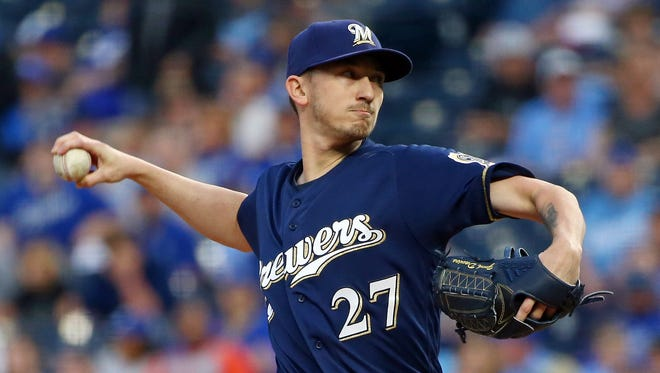 Brewers starting pitcher Zach Davies delivers a pitch in the first inning.