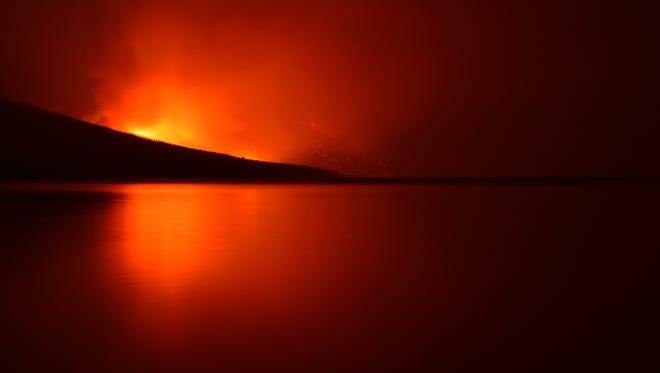 The Howe Ridge fire burns Sunday, Aug. 12, 2018, in Glacier National Park.