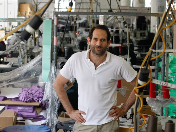 Then-CEO Dov Charney at American Apparel's factory in downtown Los Angeles in 2012. The just-fired Charney is the latest high-profile executive who has been forced out of office.