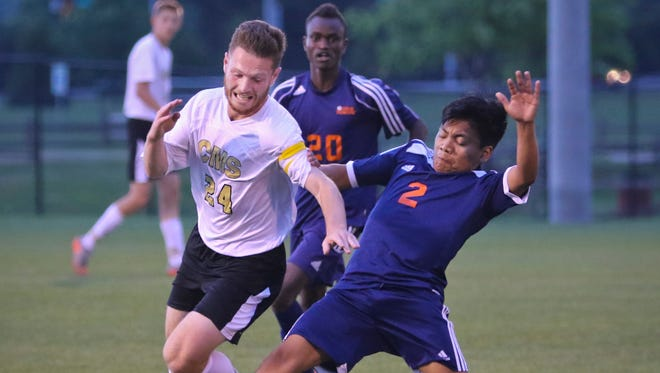 Central Magnet's Kyle Shoemaker battles East Ridge's Erik Lopez during the Tigers' 4-0 win Saturday.