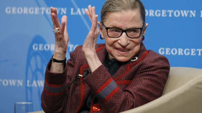FILE - In this April 6, 2018, file photo, Supreme Court Justice Ruth Bader Ginsburg applauds after a performance in her honor after she spoke about her life and work during a discussion at Georgetown Law School in Washington. The Supreme Court says Ginsburg has died of metastatic pancreatic cancer at age 87.