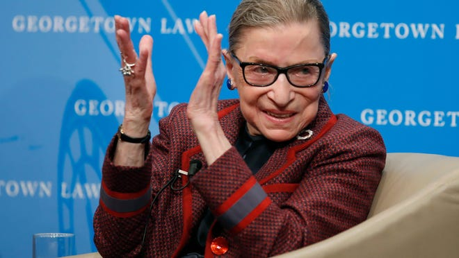 Supreme Court Justice Ruth Bader Ginsburg applauds after a performance in her honor at Georgetown Law School in Washington in April 2018. Ginsburg died of metastatic pancreatic cancer at age 87 Friday, Sept. 18, 2020.