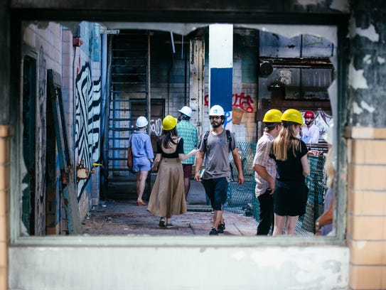 """Visitors tour the opening show for """"Modes of Construction,"""""""