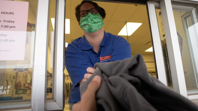 """Meranda Reed, a clerk at Scotch Cleaners' North Topeka location, is one of the employees accepting donations as part of Scotch Cleaners' annual """"Share the Warmth"""" coat drive partnership with The Salvation Army. The business began collecting coats at its Topeka locations this week and will continue accepting donations through Nov. 21."""