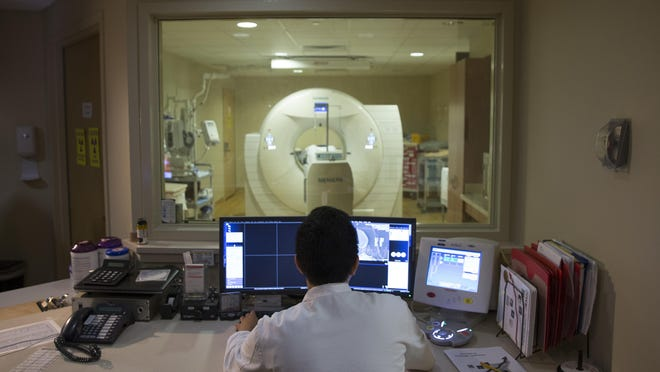 In this May 19, 2015 file photo, a nuclear medicine technologist makes a PET scan of a patient at Georgetown University Hospital in Washington. Sparrow Ionia Hospital is now offering PET/CT scans to patients on a weekly basis.