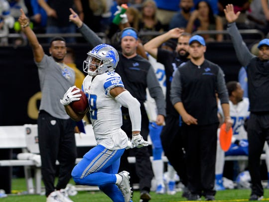 Lions' Jamal Agnew returns a punt for a touchdown in