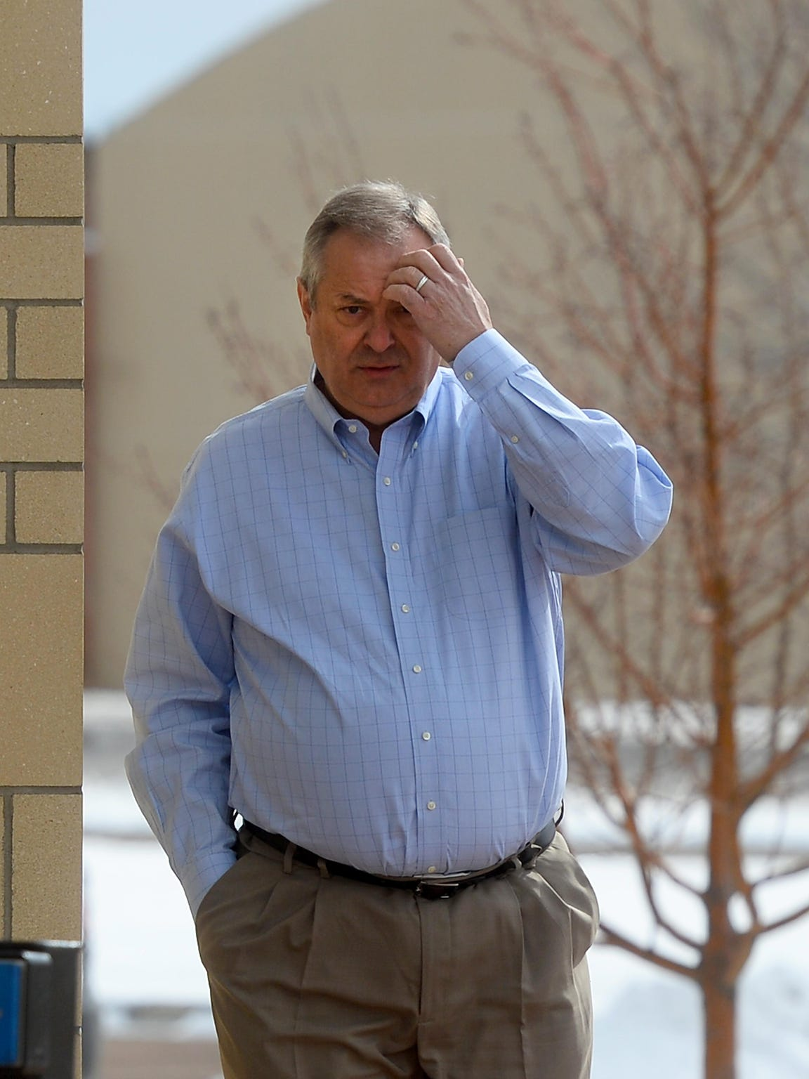 Great Falls businessman and former president of Shoot the Moon LLC Ken Hatzenbeller arrives at the Missouri River Federal Courthouse on Tuesday where he plead guilty to one count of bank fraud, a charge with a maximum sentence of 30-years in prison.