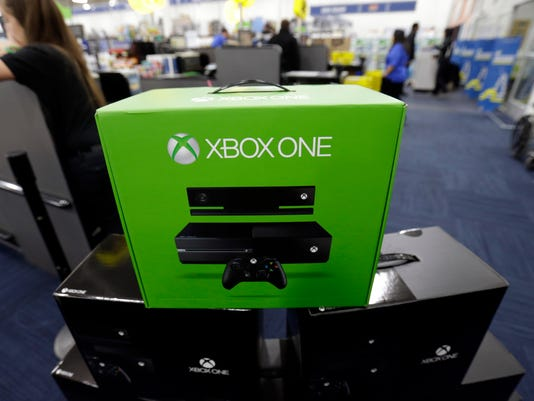 Consumers line up for Xbox One