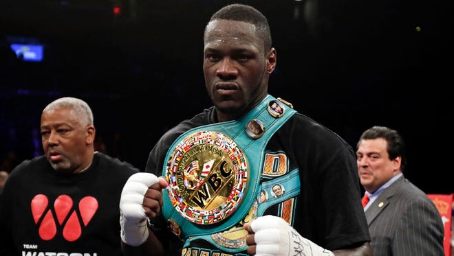 Deontay Wilder celebrates after knocking out Artur Szpilka in the ninth round of their heavyweight title boxing fight at Barclays Center.