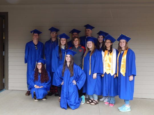Stayton High School Class of 2017 graduates who hailed from Sublimity Elementary School pose for a photo on graduation day in front of their old haunt.