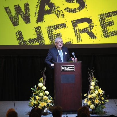 """As part of its inaugural """"Life with Phil"""" lecture Friday in the Iowa Memorial Union, the University of Iowa Foundation offered cookies decorated with with face of the main speaker, Iowa businessman and philanthropist John Pappajohn."""