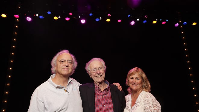 Dudley Birder, center, stands with son James Birder and daughter Alicia Birder onstage in the Walter Theatre at St. Norbert College. Dudley, 90, founded Music Theatre of St. Norbert College in 1962 and is retiring from the troupe this summer.