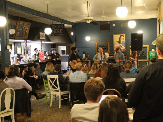 Monks Coffee House was crowded and cozy Nov. 18, when Andrew Holmes and musician friends entertained the late-night, coffee-sipping crowd.