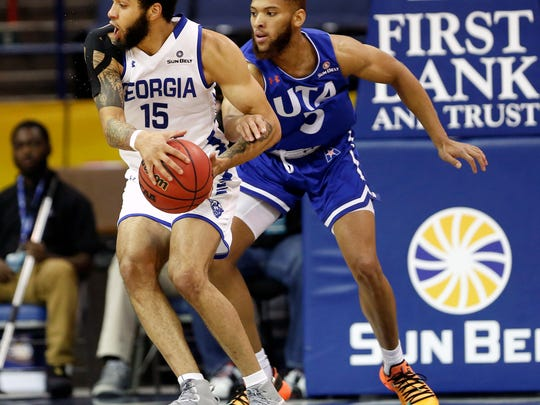 Georgia State guard D'Marcus Simonds (23) is defended by Texas-Arlington guard Edric Dennis (5) during championship game of the Sun Belt Conference Men's Tournament in New Orleans on March 17.