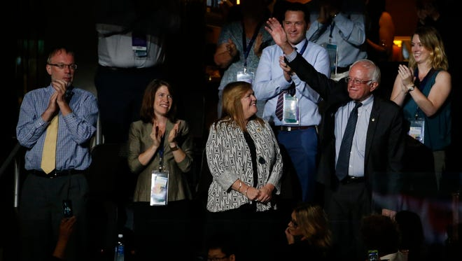 Sen. Bernie Sanders acknowledges the cheer of support during the nomination speeches.