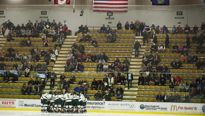Vermont huddles together before the start of the men's hockey game between the St. Lawrence Saints and the Vermont Catamounts at Gutterson Fieldhouse on Friday.