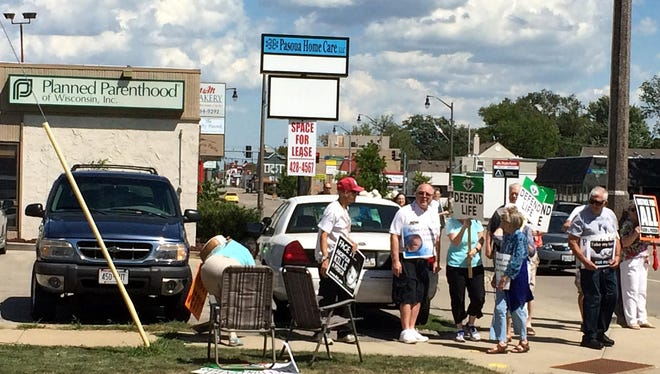 Protesters gathered Thursday at Planned Parenthood, 508 W. Wisconsin Ave., Appleton.
