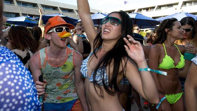 Electronic dance music fans enjoy a recent Splash House party at the Hard Rock Hotel Palm Springs. The second Splash House of the summer begins Saturday, August 8.