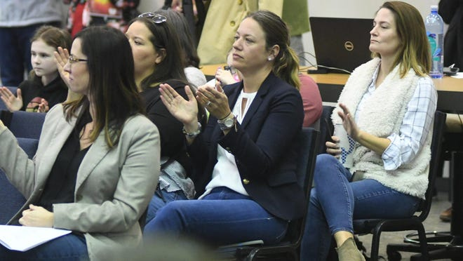 People applaud after the Rev. Dante Murphy spoke out against the handling of the latest teacher sex-crime charges. Murphy spoke at the Feb. 4 New Hanover County Board of Education meeting.