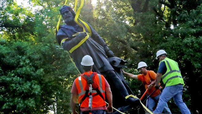 A statue of Christopher Columbus, erected in Tower Grove Park 140 years ago, was taken down Tuesday at the direction of the park's Board of Commissioners.
