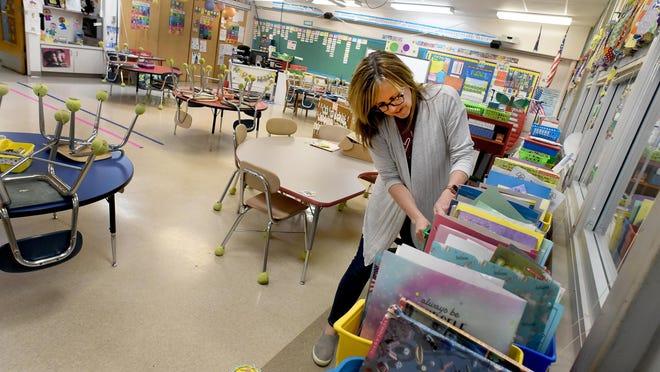 A Summerfield Elementary School teacher cleans her classroom after the 2019-20 school year. Summerfield Schools resumes Sept. 8.