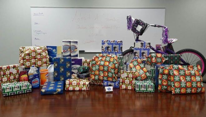 Cellular & More with a store in Canton, adopted 15 families in need for Christmas.