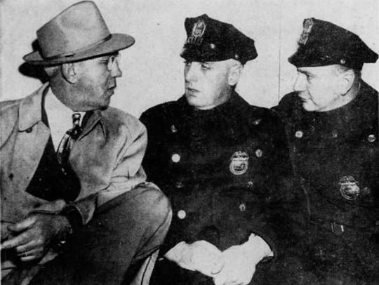 Police Officer Ralph Boryszewski, right, confers with