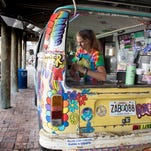 Annabelle Owens cleans bottles as she waits for customers at the Sno Cones! stand set up outside of Flounders Chowder House in Pensacola Beach, FL on Thursday, June 16, 2016.  Beach leaders are consider ing parking lot food trucks.