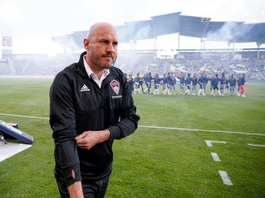 The Colorado Rapids' new coach, Conor Casey, rolls up his sleeves before the team's MLS soccer match against the Vancouver Whitecaps on Friday, May 3, 2019, in Commerce City, Colo. (AP Photo/Jack Dempsey)