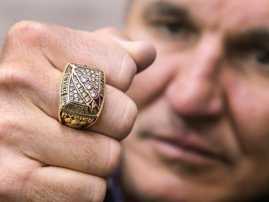 Mark Rypien displays his Super Bowl ring in Spokane.