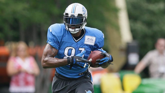 Detroit Lions wide receiver Calvin Johnson runs through drills Aug. 5, 2014.