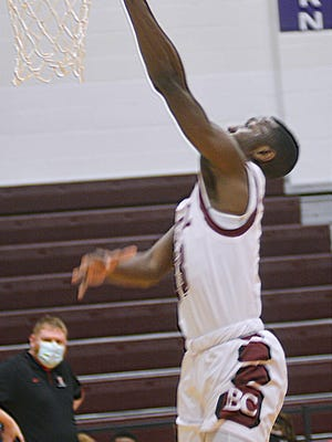 Bethel junior Clifford Byrd II lays one in during play Wednesday against KCAC leaders McPherson. Byrd scored 18 points with 8 rebounds and 5 steals.