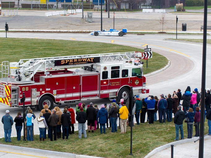 A Speedway Fire Department engine parades past the