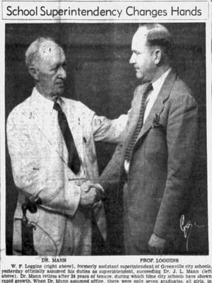 In this 1940 file photo, J.L. Mann (left) shakes hands with his successor as superintendent, W.F. Loggins.