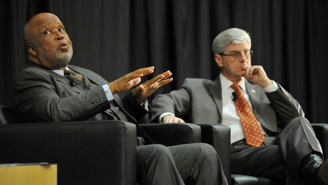 In this Jan. 30, 2014, file photo, U.S. Rep. Bennie Thompson, left, and Gov. Phil Bryant have a discussion on race and faith during the Governor's Prayer Luncheon at the Jackson Convention Complex in Jackson.